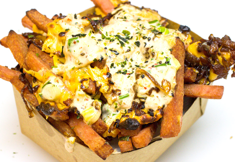 Spanimal Fries - Served with American cheese, Asian 1000 island sauce (Mayo, Kimchi, green onions, ketchup, rice wine vinegar) Soy glazed caramelized onions, Furikake Seasoning (Furikake is a Japanese blend of: ground shiso leaf, powdered soy sauce or miso, sesame seeds)